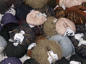 Winter Yarns This mixed lot includes a total of 2000 gr (70.5 oz.) leftover yarns. There is no standard for fiber content and weight. Also disregard any information on the labels. You will get what you see in the photo. Brand ICE, fnt2-58710