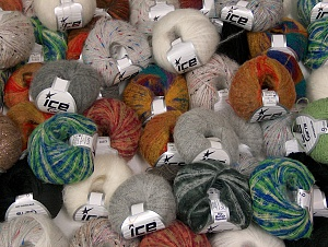 Winter Yarns This mixed lot includes a total of 2000 gr (70.5 oz.) yarn. There is no standard for ball weight. Also disregard any information on the labels. You will get what you see in the photo. Brand ICE, fnt2-63245